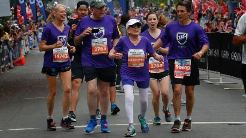 Harriette Thompson approaches the finish line for Synchrony Financial Rock 'n' Roll Half Marathon in