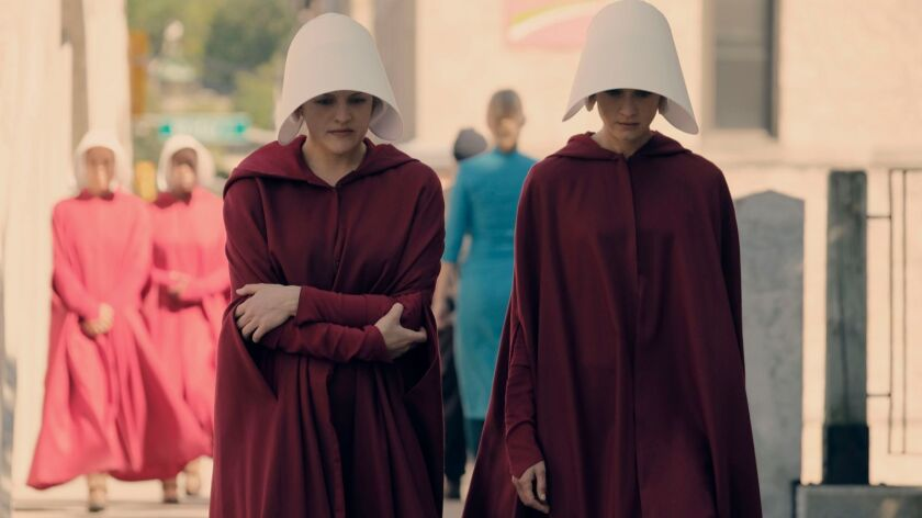 Offred (Elisabeth Moss) and Ofglen (Alexis Bledel) are fellow sexual surrogates in a dystopian futur