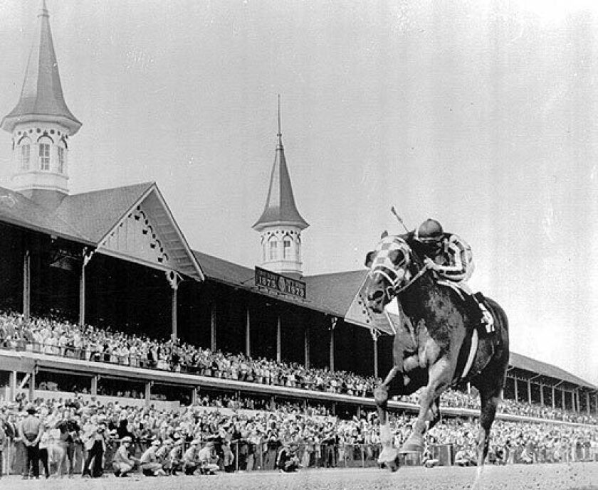 Secretariat, with jockey Ron Turcotte, crosses the finish line to win the Kentucky Derby in 1973.