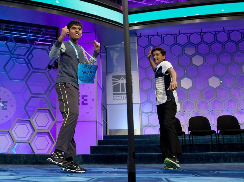 Nihar Janga, 11, of Austin, Texas, left, and Jairam Hathwar, 13, of Painted Post, N.Y., celebrate after being named co-champions in the 2016 National Spelling Bee, in National Harbor, Md., on Thursday, May 26, 2016. (AP Photo/Jacquelyn Martin)