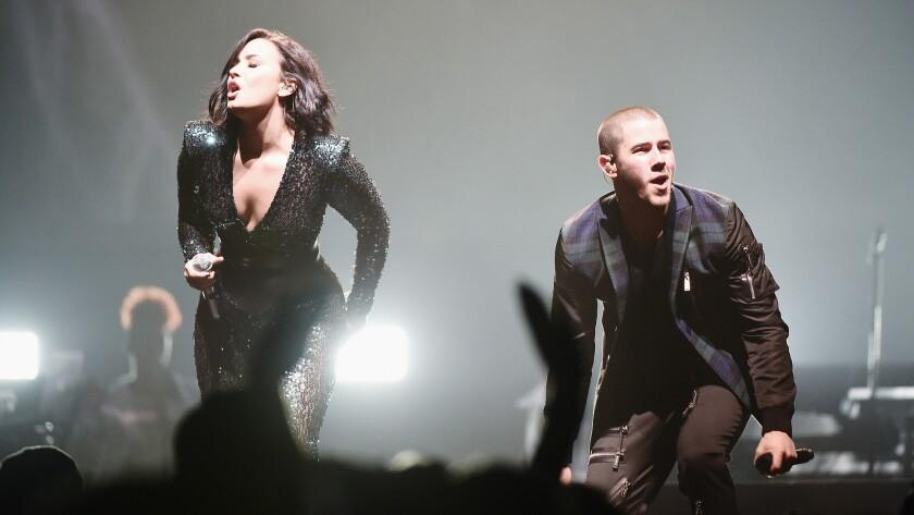 Demi Lovato and Nick Jonas perform last month in Brooklyn.