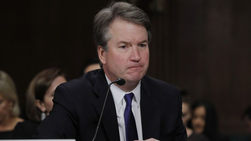 Supreme Court nominee Brett Kavanaugh testifies before the Senate Judiciary Committee on Thursday. The panel approved Kavanaugh's nomination Friday on a party-line vote, but a full vote on the Senate floor is delayed.