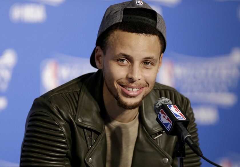 Golden State Warriors guard Stephen Curry smiles during a news conference after Game 7 of the NBA basketball Western Conference finals against the Oklahoma City Thunder in Oakland, Calif., Monday, May 30, 2016. The Warriors won 96-88. (AP Photo/Ben Margot)