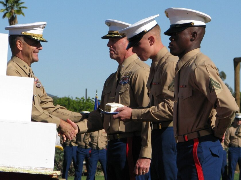 Passing the cake at 239th Marine Corps Birthday cake-cutting ceremony.