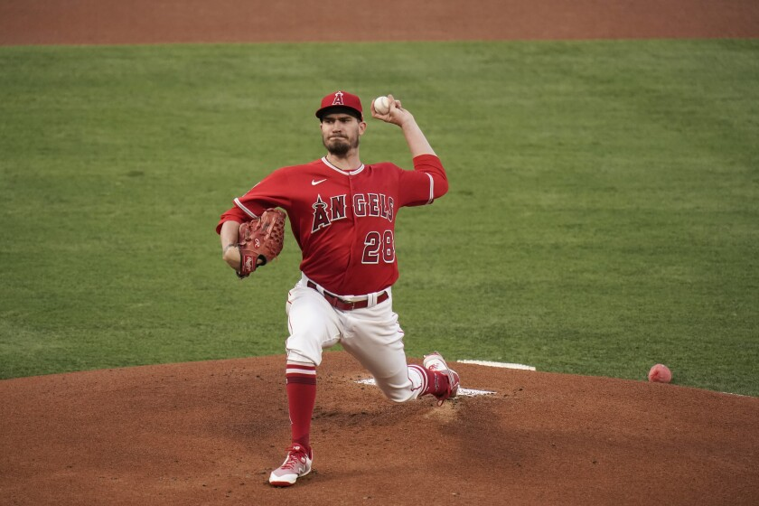 Andrew Heaney releases a pitch.