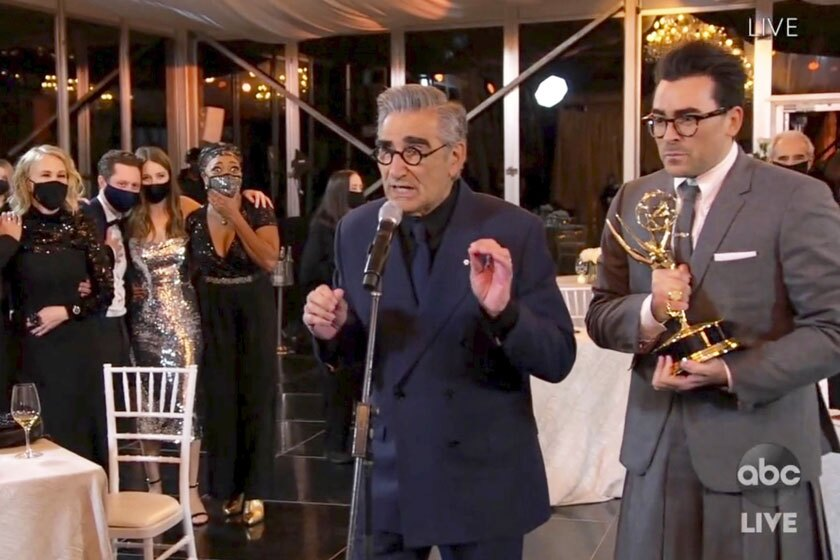 """Schitt's Creek"" stars Eugene Levy, left, and Dan Levy accept an Emmy on Sunday."