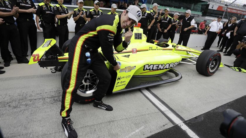 Simon Pagenaud, of France, celebrates after winning the pole for the Indianapolis 500 IndyCar auto r