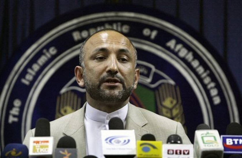Interior Minister Hanif Atmar speaks to the media after submitting his resignation in Kabul, Afghanistan, Sunday, June 6, 2010. Afghanistan's intelligence chief and interior minister resigned Sunday to take responsibility for allowing militants to elude a massive security operation and launch an attack on last week's national peace conference. (AP Photo/Ahmad Massoud)