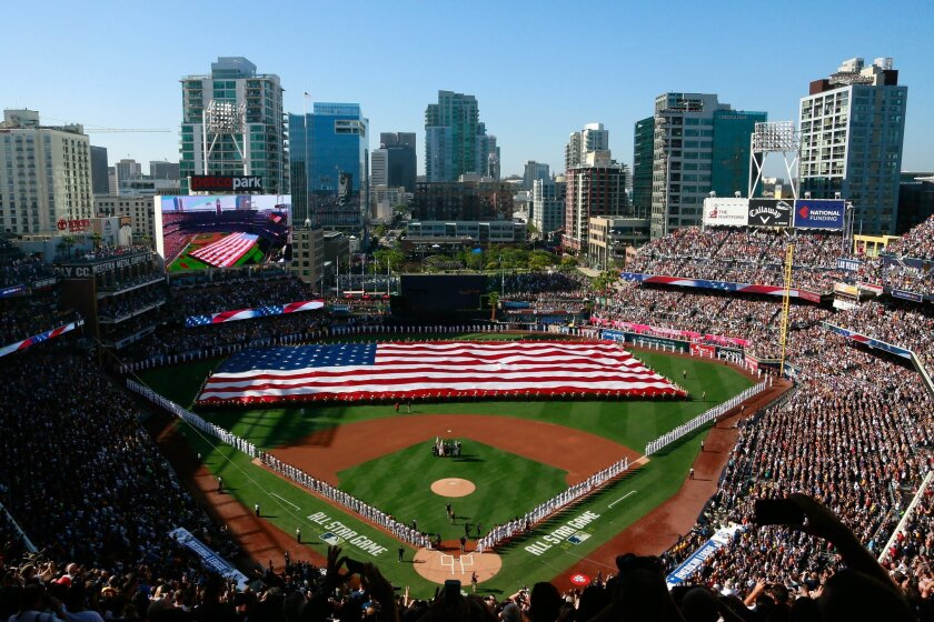 The American flag is unfurled by Marines as the National Anthem is sung during the pre-game ceremony before the start of the MLB All-Star Game at Petco Park Tuesday.