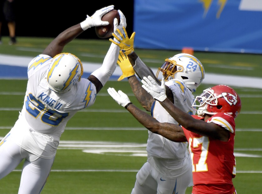 Defensive back Desmond King, left, of the Los Angeles Chargers intercepts a pass intended for wide receiver Mecole Hardman, right, of the Kansas City Chiefs in the second half of an NFL football game at SoFi Stadium in Inglewood, Calif., on Sunday, Sept. 20, 2020. Kansas City Chiefs won 23-20 in overtime. (Keith Birmingham/The Orange County Register via AP)