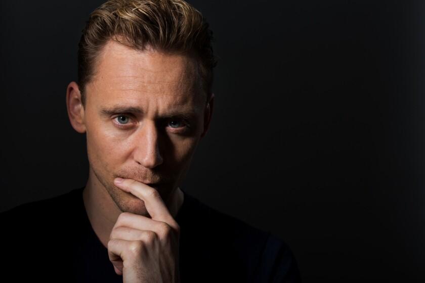 British actor Tom Hiddleston walks to the edge of his Hank