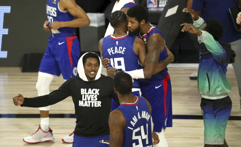 Clippers players celebrate a win over the Portland Trail Blazers on Aug. 8, 2020.