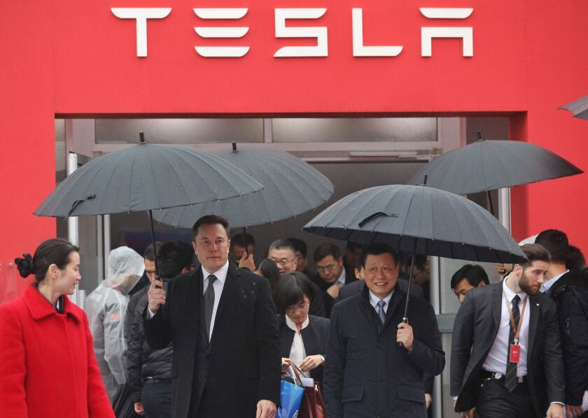 Tesla CEO Elon Musk has tweeted nothing about the current state of Tesla's new Shanghai factory, nor has he publicly issued other corporate information related to the coronavirus. Above, Musk with Shanghai Mayor Ying Yong last year during the ground-breaking ceremony for Tesla's factory in Shanghai.