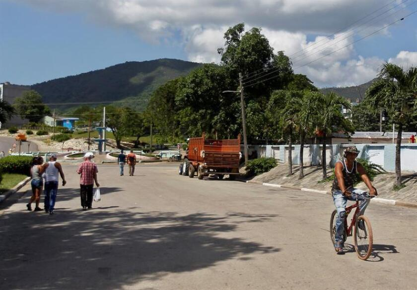 Local residents stroll around the Cuban town of Segundo Frente, which former President Raul Castro has adopted as his hometown and where he may retire in 2021 after stepping down as head of the Cuban Communist Party. EFE-EPA/Yander Zamora