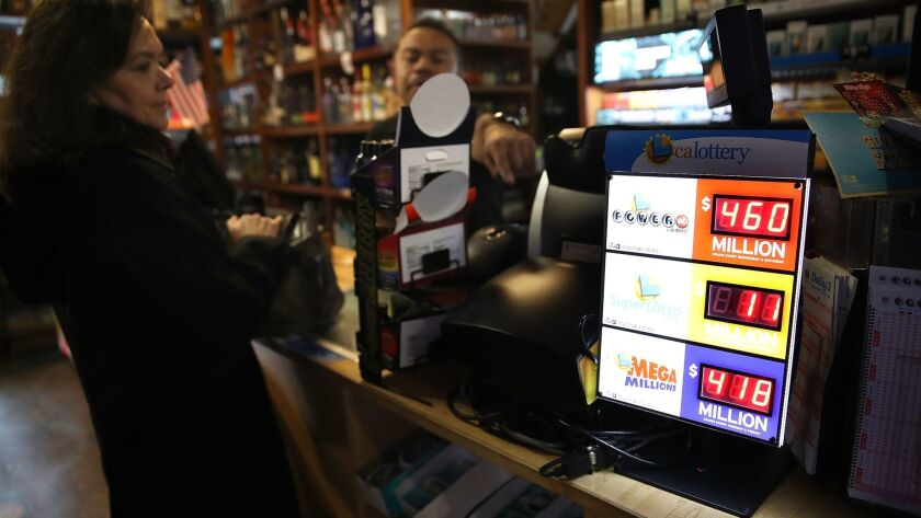 A customer buys lottery tickets Wednesday at a convenience store in San Francisco.