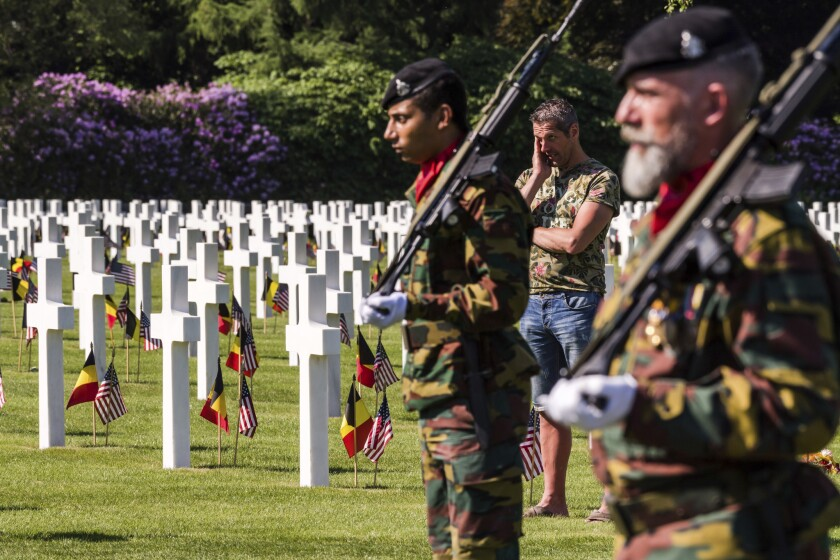 Honor guards march at a Memorial Day ceremony at the Henri-Chapelle American Cemetery and Memorial in Belgium. It includes 7,992 U.S. military dead.