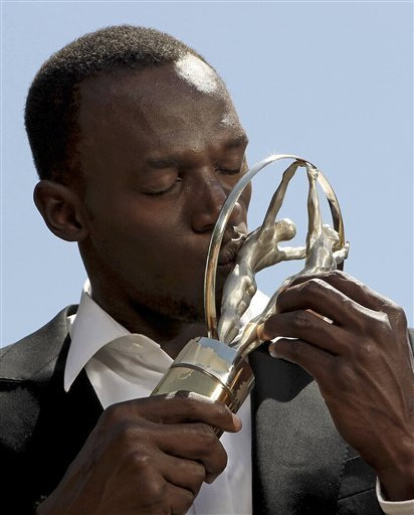 In this image released by the Laureus Awards on Wednesday March 10, 2010, Jamaican sprint star Usain Bolt kisses the Laureus World Sportsman of the Year Award in Kingston, Jamaica. Bolt who won the Laureus World Sportsman of the Year for the second year running, was unable to attend the awards cere