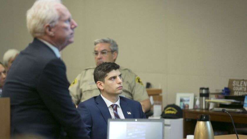 Richard Sepolio, right, whose truck plunged off the Coronado Bridge, killing four people and injuring several others, and his attorney Paul Pfingst, left, look at the projection screen during opening statements on the first day of Sepolio's trial on Jan. 14.