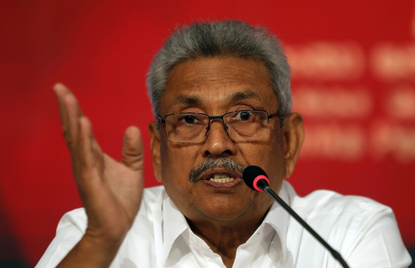 Sri Lankan presidential candidate and former defense chief Gotabaya Rajapaksa speaks during a news conference in Colombo, Sri Lanka, Tuesday, Oct. 15, 2019. Rajapaksa, who's a front-runner in next month's presidential election says if he wins he won't recognize an agreement the government made with the U.N. human rights council to investigate alleged war crimes during the nation's civil war. (AP Photo/Eranga Jayawardena)