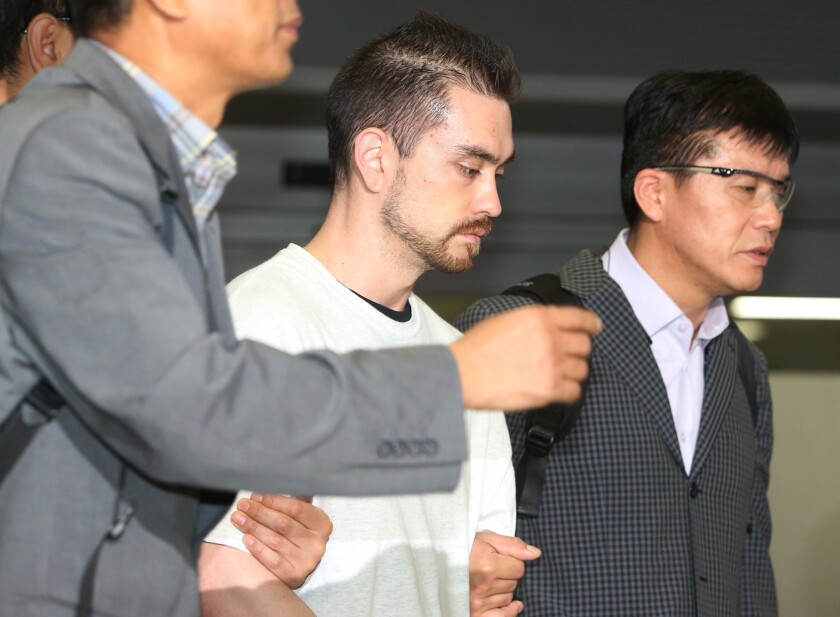 Arthur Patterson, center, is escorted by South Korean police upon arriving at Incheon International Airport on Sept. 23, 2015.