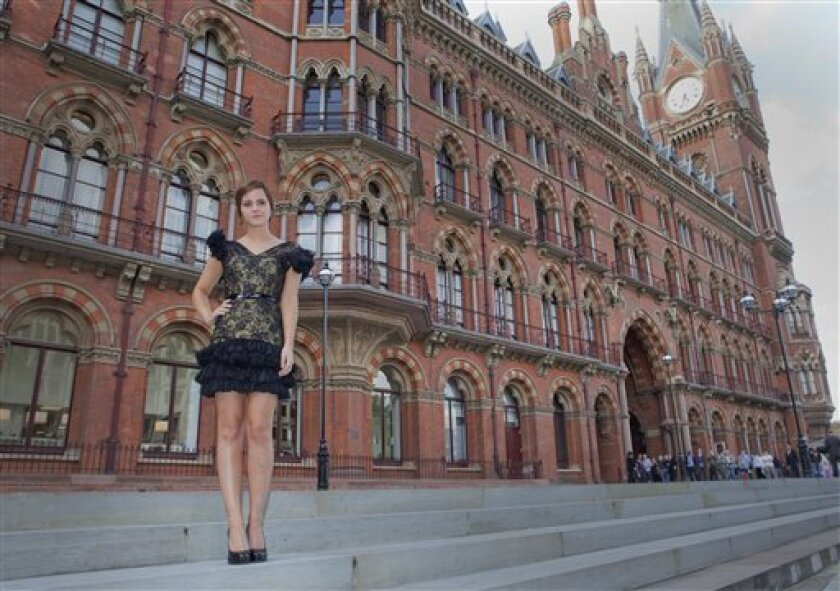 British actress Emma Watson poses at St Pancras Renaissance Hotel in central London, ahead of the world premiere of Harry Potter and The Deathly Hallows: Part 2, the last film in the series, Wednesday, July 6, 2011. (AP Photo/Joel Ryan)