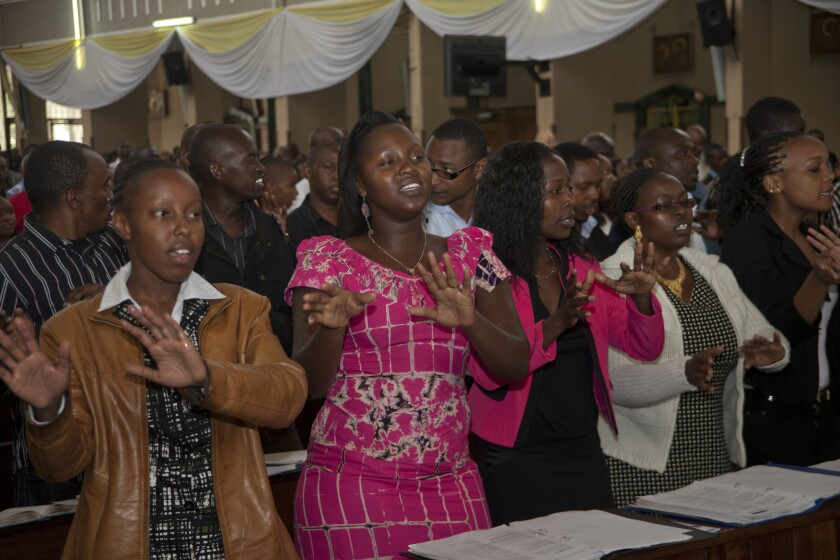 Kenyan Christians sing during an Easter morning service at Holy Family Basilica in Nairobi. Prayers were said for victims of last week's attack in Garissa.
