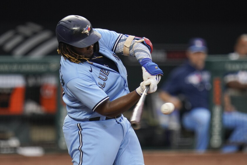 Toronto Blue Jays' Vladimir Guerrero Jr. connects for a single against the Baltimore Orioles during the third inning of a baseball game, Wednesday, July 7, 2021, in Baltimore. (AP Photo/Julio Cortez)