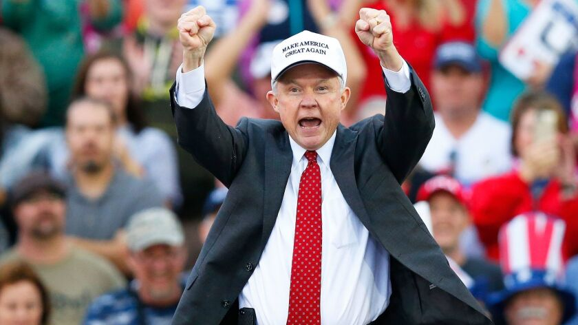 Attorney General-designate, Sen. Jeff Sessions, R-Ala, cheers on the crowd during a rally for President-elect Donald Trump at the Ladd–Peebles Stadium in Mobile, Ala. on Dec. 17.