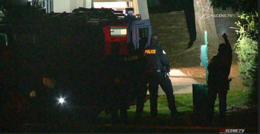 Police surround an apartment complex in Oceanside where a man allegedly stabbed his wife.