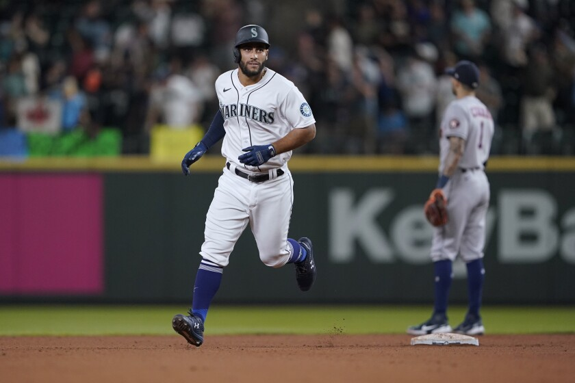Seattle Mariners' Abraham Toro rounds the bases after hitting a two-run home run against the Houston Astros during the ninth inning of a baseball game, Tuesday, July 27, 2021, in Seattle. Toro was traded to the Mariners from the Astros earlier in the day. The Astros won 8-6. (AP Photo/Ted S. Warren)