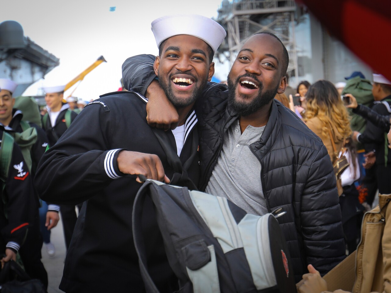 Navy Petty Officer 1st Class Elijah Abdullah, a crew member on the USS Boxer, the flagship of the Boxer Amphibious Ready Group, was greeted by his brother, Mustafa Abdullah Jr., after he arrived at Naval Base San Diego, November 27, ending a seven-month deployment,