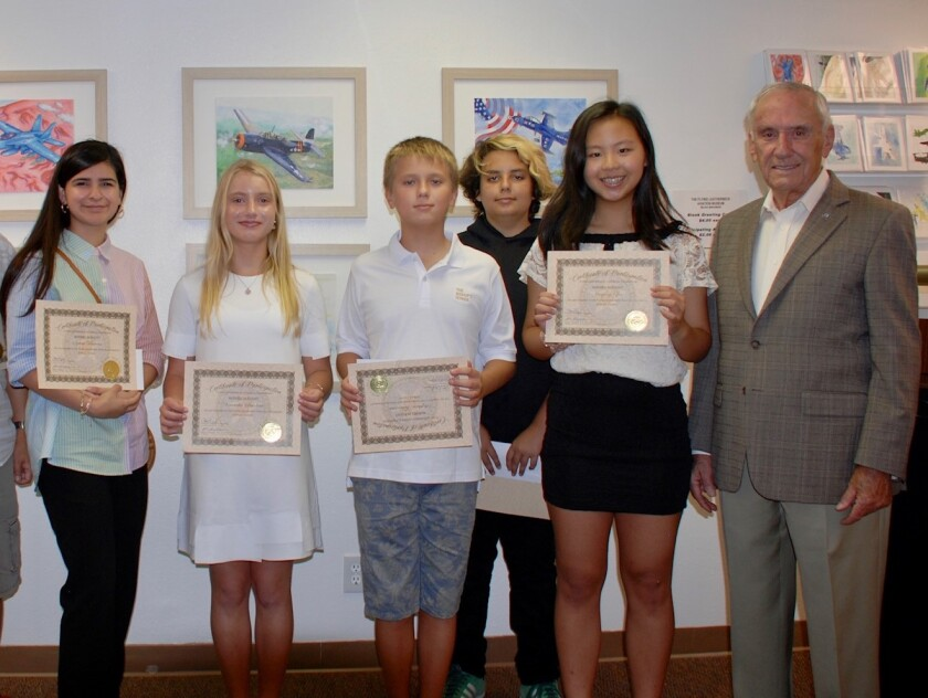 From left, winners of the Flying Leatherneck Aviation Museum art contests: Sylvia Paredes, Veronika Smolina, Stephan Talantov, Charlie O'Brien, Jiaying Zhu and retired U.S. Marine Corps Maj. Gen. Bob Butcher, chairman of the Flying Leatherneck Historical Foundation. Not pictured: Roma Ghanekar.