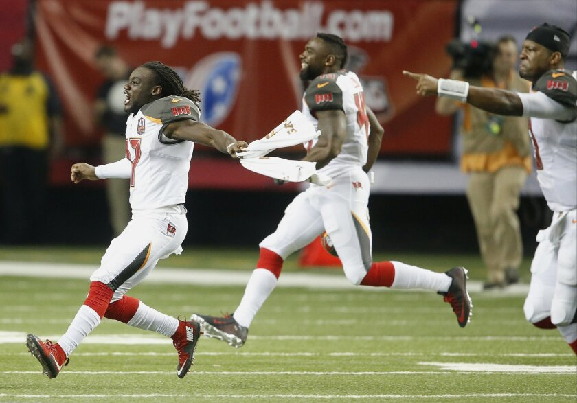 Tampa Bay Buccaneers wide receiver Donteea Dye (17) runs onto the field after overtime of an NFL football game against the Atlanta Falcons, Sunday, Nov. 1, 2015, in Atlanta. The Tampa Bay Buccaneers won 23-20. (AP Photo/John Bazemore)