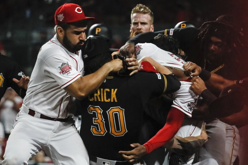 Pittsburgh Pirates' Kyle Crick, center, brawls with Eugenio Suarez, left, and Amir Garrett, center right