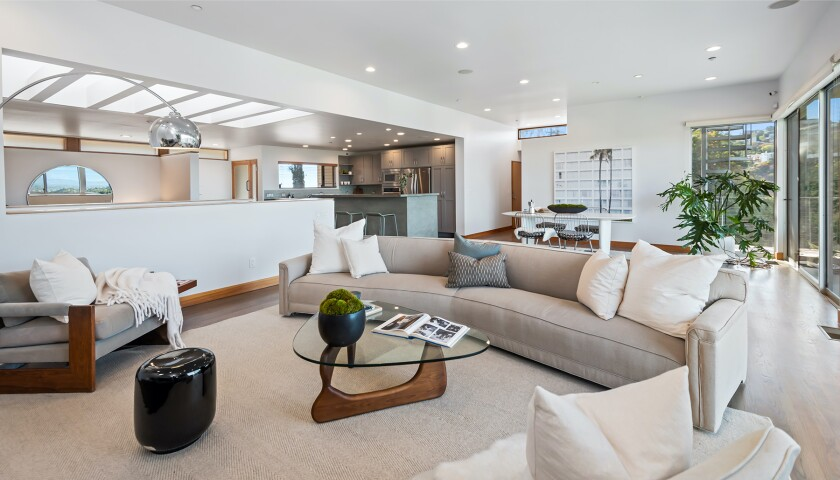 A room in the Hollywood Knolls home has light-filled living spaces with clerestories, skylights and walls of glass.