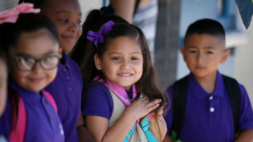 First grade students are ready to head to the classroom on the first day of school at the Telesis Academy in West Covina, Calif. on August 15, 2016.