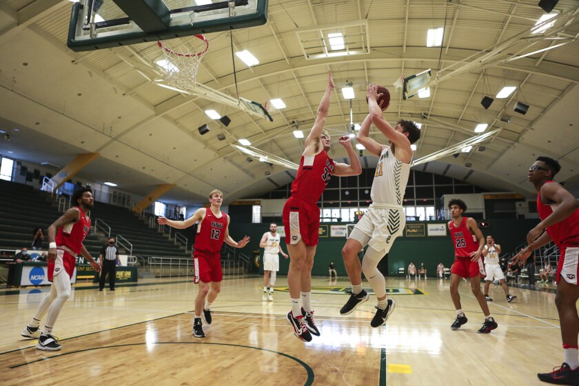 Point Loma's Brian Goracke shoots against Northwestern Nazarene in their season opener Jan. 15. The Sea Lions won 87-57.