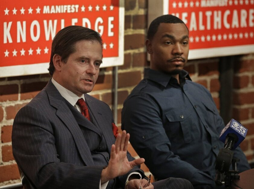 Attorney Christopher Dolan, left, representing the family of Jahi McMath, with Omari Sealey, Jahi's uncle, during a new conference this month. In a recent Times Op-Ed article, Dolan blasted critics of Jahi's family.