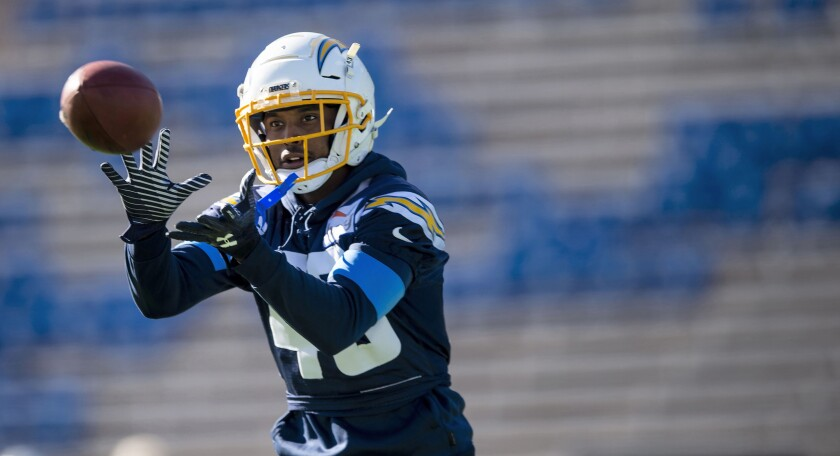 Chargers cornerback Michael Davis catches a pass in practice.