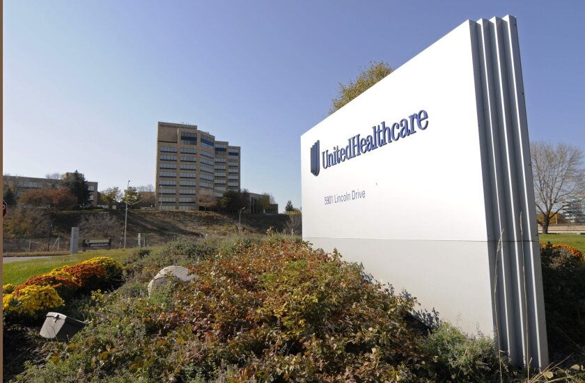 Health insurer UnitedHealth cut its earnings forecast, citing hits it expects to take from public insurance exchanges.