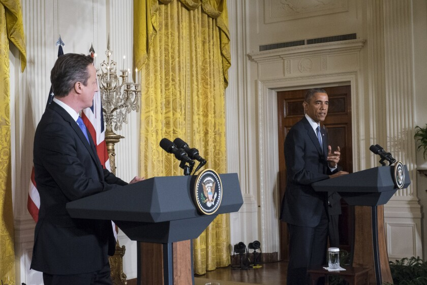 President Obama speaks during a joint news conference with British Prime Minister David Cameron in the East Room of the White House on Friday.