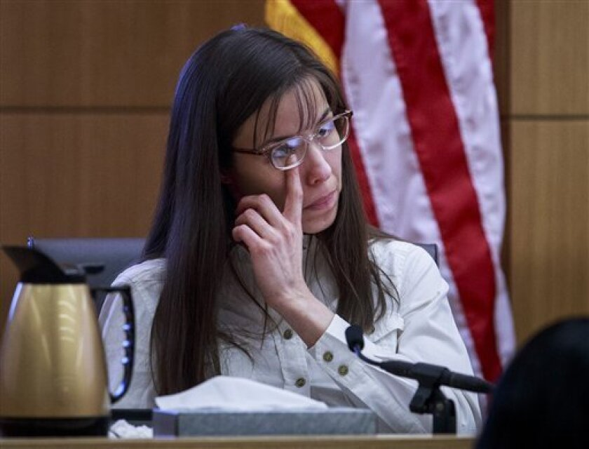 Defendant Jodi Arias talks about the text messages with Travis Alexander from March through May 2008, as she testifies in her murder trial st Judge Sherry Stephens' Superior Court , on Tuesday, Feb. 19, 2013.  Arias is charged in the 2008 stabbing and shooting death of her lover, Alexander.  She fa