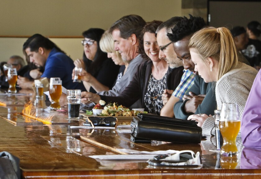 People take in food and drink at the new Belching Beaver Brewery Tavern and Grill that recently opened in downtown Vista. The brewery also has locations in Oceanside and North Park.