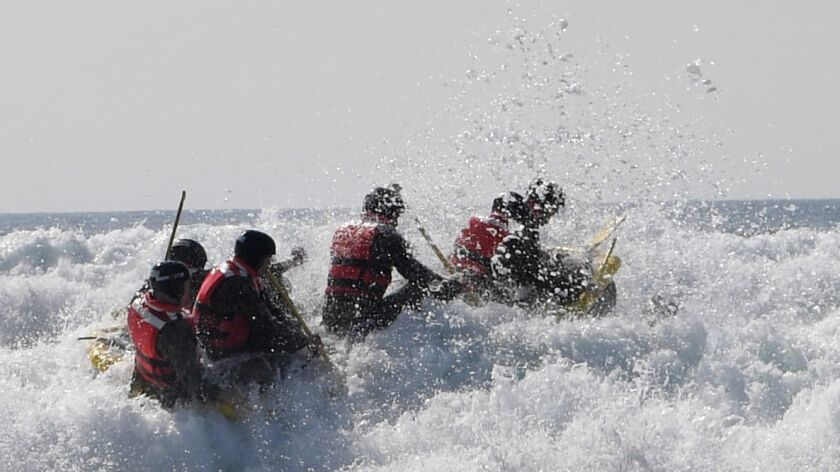 "Basic Underwater Demolition/SEAL students participate in ""Surf Passage"" on Feb. 6 at Naval Amphibious Base Coronado."