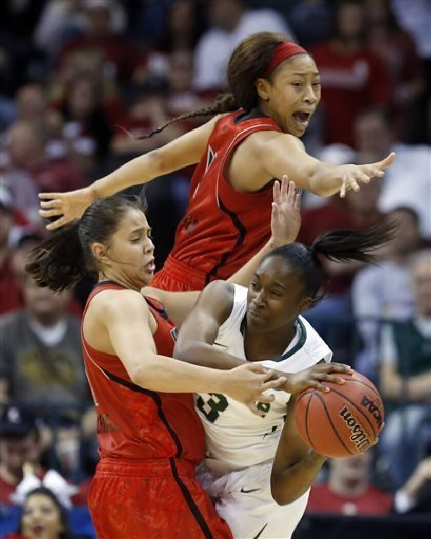 Louisville guard Shoni Schimmel, left, and guard Antonita Slaughter, top, pressure Baylor guard Jordan Madden (3) as she looks for a teammate to pass to in the first half of a regional semifinal game in the women's NCAA college basketball tournament in Oklahoma City, Sunday, March 31, 2013. (AP Pho