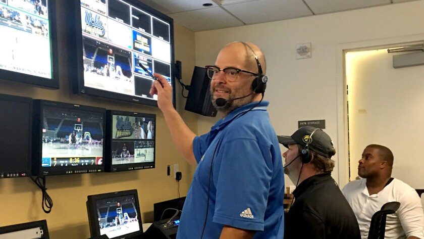 "Dan Valdivia, director of DodgerVision, chooses the shots that appear on the Dodgers' video board during the ""Kiss Cam"" segment."