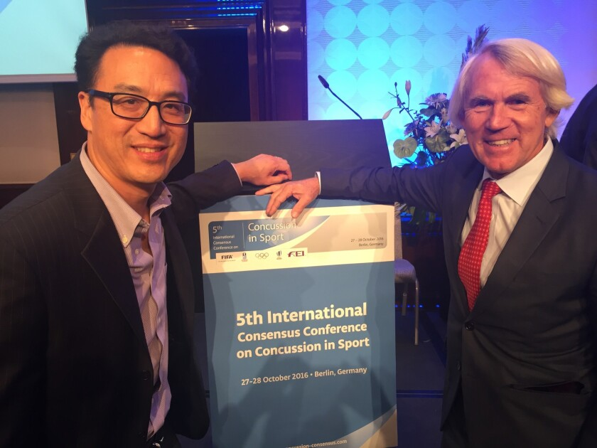 (L-r) Douglas Chang, M.D., Ph.D., Chief, Physical Medicine and Rehabilitation Clinical Professor UCSD Department of Orthopaedic Surgery, with Dr. Jiri Dvorak, Chief Medical Officer of the FIFA (World Cup Soccer organization) at the conference in Berlin, Germany.
