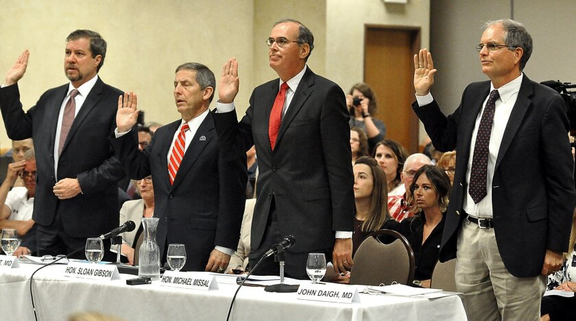 Witnesses from the Department of Veterans Affairs, from left, Gavin West, a senior medical adviser, Sloan Gibson, a deputy secretary, Michael Missal, an inspector general, and John Haigh, an assistant inspector general for health care inspections, are sworn in during a field hearing of the Senate H