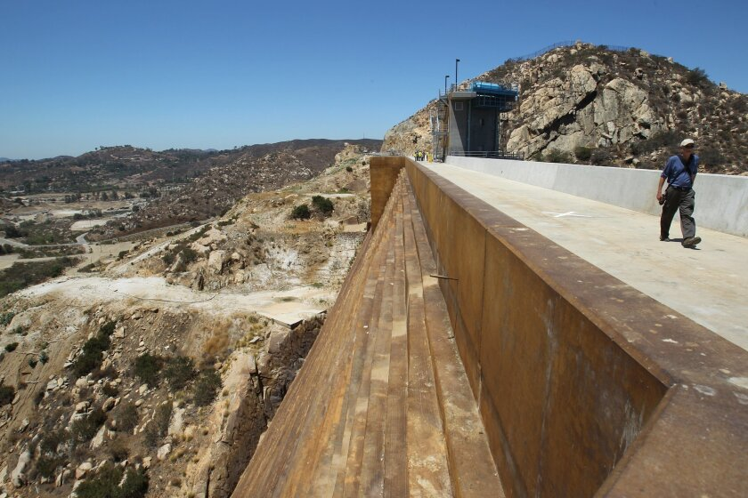 The San Vicente dam raise project has been officially dedicated with the 117 foot addition to the earthen toned concrete structure being dedicated on Wednesday, July 16th.