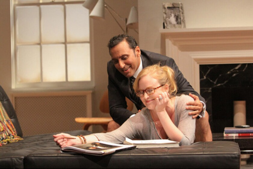 """A scene from """"Disgraced,"""" with Aasif Mandvi and Heidi Armbruster, produced by Lincoln Center Theater in 2012."""